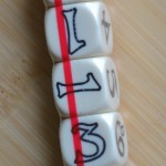 The dice before being freed from the red restraining band.
